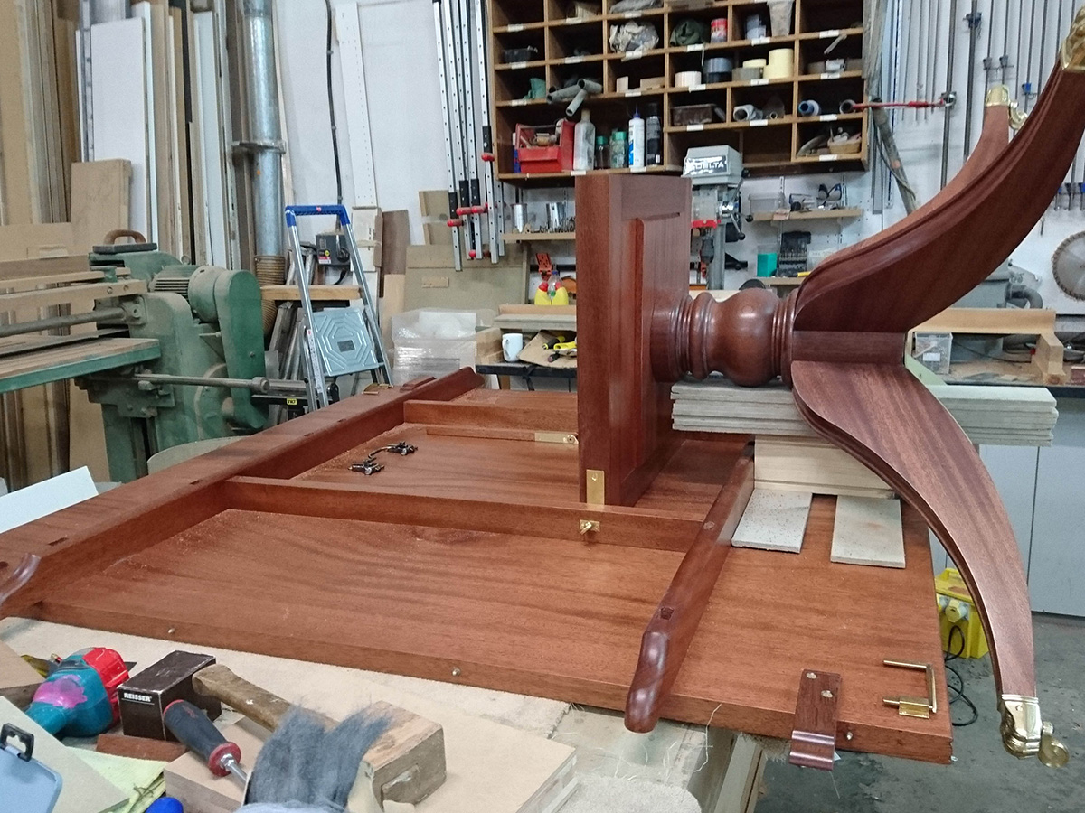 Assembly of bespoke mahogany dining table