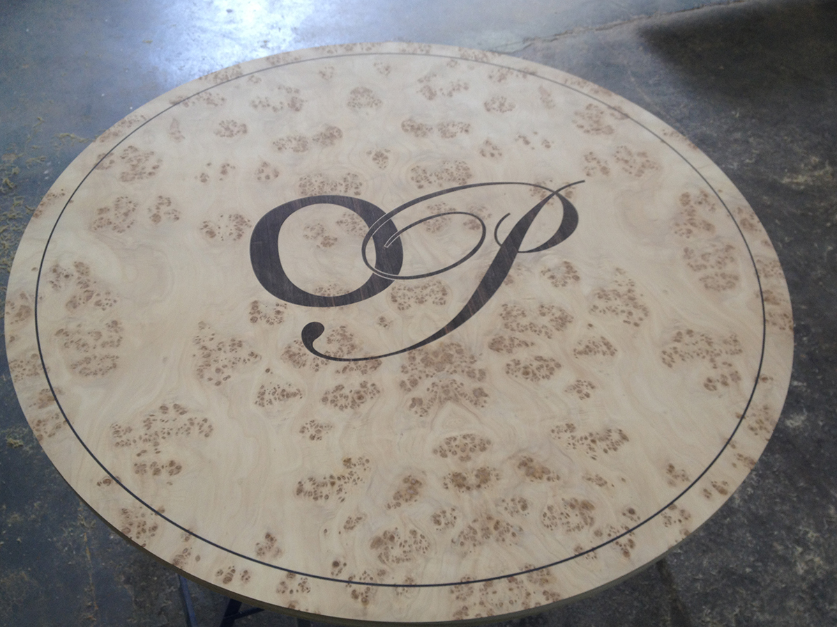 Poplar table top with ebony inlay corporate logo